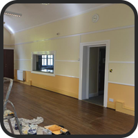 Side View of a Room Being Painted